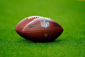 The NFL shield logo is seen on an official NFL football, nicknamed