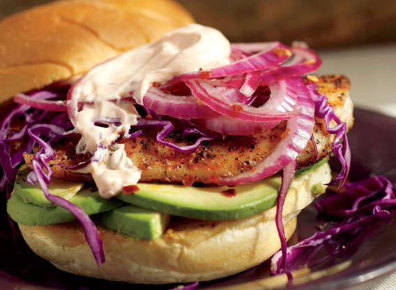 Slide 4 of 63: Our fish sandwich replaces processed patties with fresh tilapia fillets, opts for blackening instead of frying, and uses creamy avocado and a yogurt-based sauce instead of tartar sauce. If you're wondering if you should eat tilapia, we've got the answer.Get our recipe for Blackened Fish Sandwich With Avocado and Cabbage.