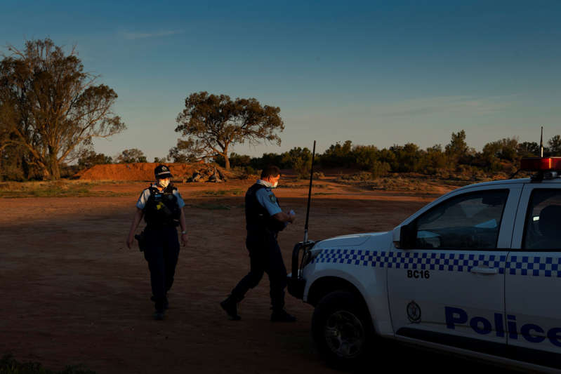 Police visit the campground temporary isolation facility to check on residents on Aug. 31. Once a prosperous river port, Wilcannia has faded into a struggling Outback pit stop.
