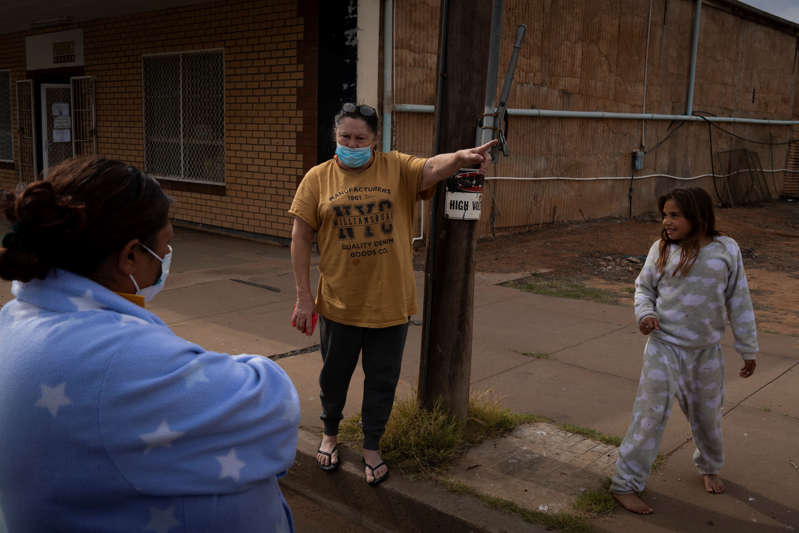 Saphire Hall, left, talks with Janell Evans and her granddaughter Hayley Dutton-Parke outside a store in Wilcannia.
