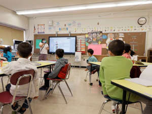 Melissa Wong, a teacher at Yung Wing School PS 124, teaches her masked students in their classroom on September 27, 2021, in New York City.