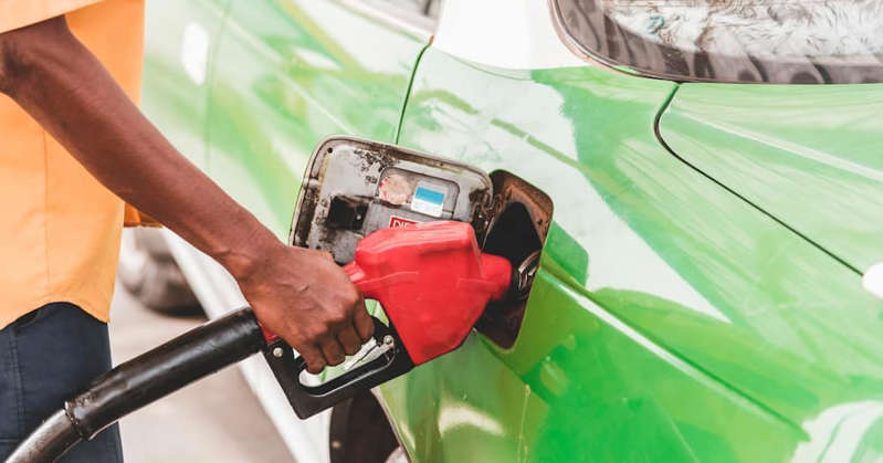 Fueling car with petrol pump at a gas station. Photo: Getty Images. Source: Getty Images