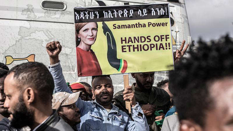 A protester holds a banner denouncing USAID chief Samantha Power during a rally against TPLF rebels in Addis Ababaforces on August 08, 2021