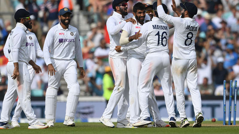 a group of baseball players standing on top of a field: India celebrates a wicket on the final day of the fourth Test against England.