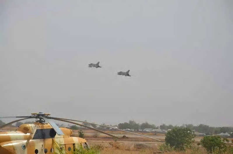 a helicopter flying in the sky: Some bandits have lost their lives after their logistics base was bombarded by Nigeria's military air troops