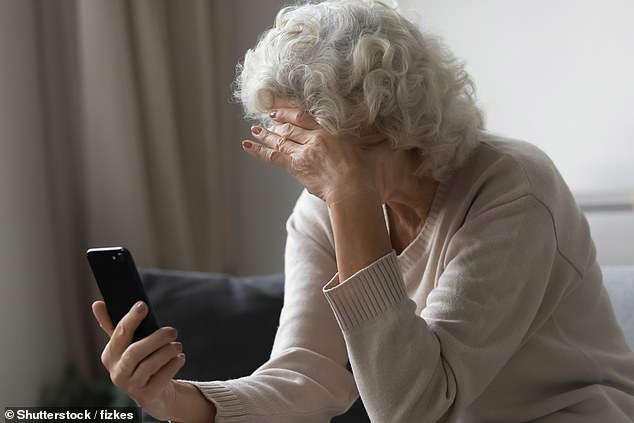 a woman looking at her cell phone: (