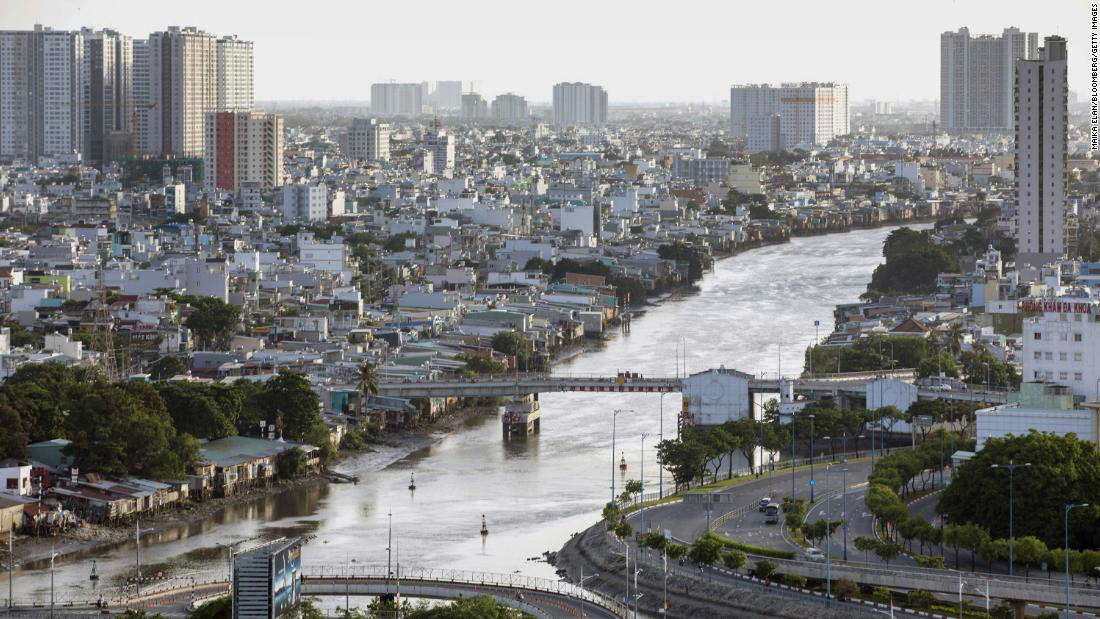 a river running through a city: Roads are deserted in Vietnam's Ho Chi Minh City during a stay-at-home order on August 5.