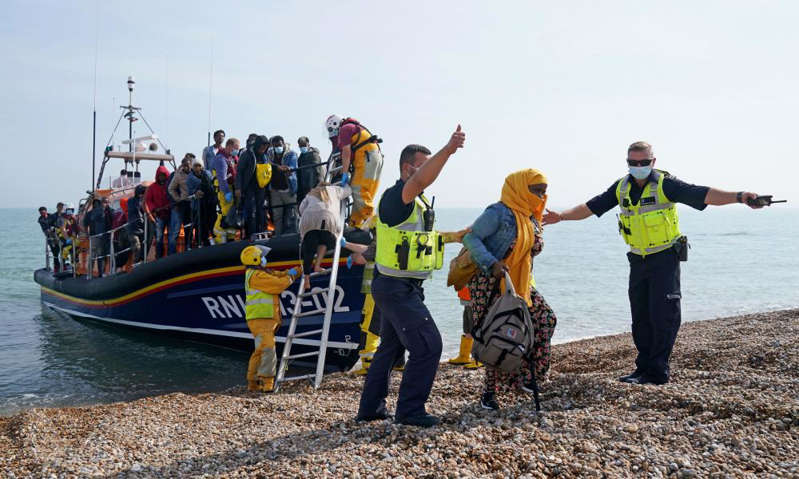 a group of people on a boat in the water: Photograph: Gareth Fuller/PA