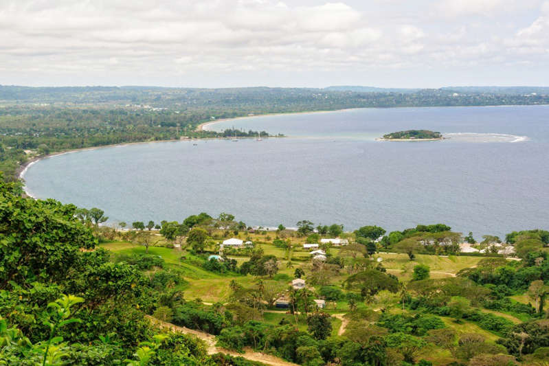 a large body of water with a mountain in the background: Mele Bay in Port Vila. Most buyers of Vanuatu property are investors, with fewer than half intending to use these properties themselves, according to Juwai IQI. Photo: Handout