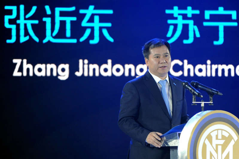 Zhang Jindong holding a sign: Zhang Jindong delivers a speech during a press conference on Suning's Acquisition of Inter Milan in Nanjing, Jiangsu province in June 2016. He paid US$306 million for about 70 per cent of the club. Photo: AFP