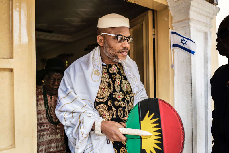 Political activist and leader of the Indigenous People of Biafra (IPOB) movement, Nnamdi Kanu, wears a Jewish prayer shawl as he leave his house in Umuahia, southeast Nigeria, on May 26, 2017, to meet veterans of the Nigerian civil war, whose 50th anniversary will be commemorated on May 30.  The war was triggered when the Igbo people, the main ethnic group in the southeast, declared an independent breakaway state, the Republic of Biafra.  / AFP PHOTO / MARCO LONGARI        (Photo credit should read MARCO LONGARI/AFP via Getty Images)