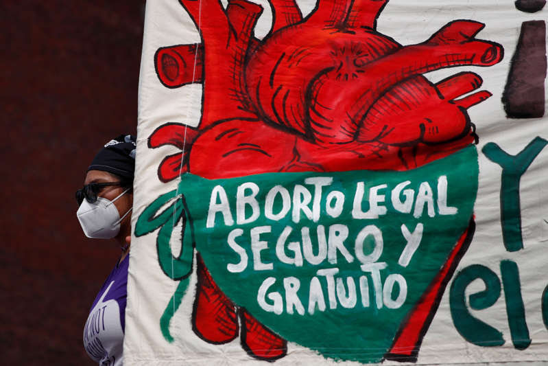 """In this Sept. 28, 2020 file photo, a woman holds a banner reading, in Spanish, """"Legal, safe, and free abortion, legalize and decriminalize abortion now, for the independence and autonomy of our bodies,"""" as abortion-rights protesters demonstrate in front of the National Congress on the """"Day for Decriminalization of Abortion in Latin America and the Caribbean,"""" in Mexico City. The Supreme Court of Mexico on Tuesday, September 7, 2021, annulled several statutes on the northern state of Coahuila that criminalized abortion."""