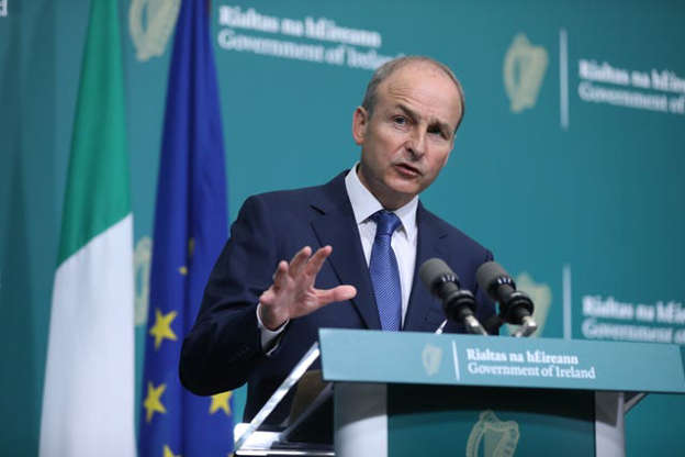 Micheal Martin wearing a suit and tie: Taoiseach Micheal Martin speaking at a press conference at Government Buildings (Julien Behal/PA)