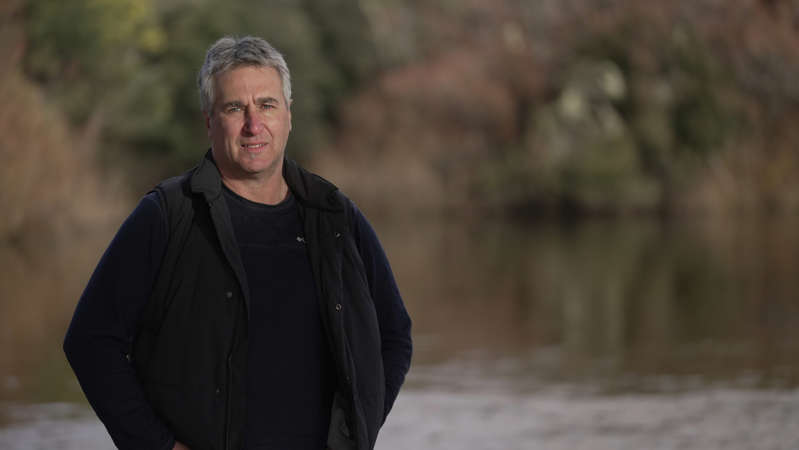 a man smiling for the camera: Rick Lohrey rarely fishes the South Esk River in Tasmania these days. (ABC News: Owain Stia-James)