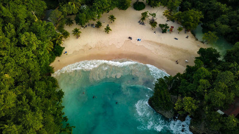 a river surrounded by trees: An aerial shot of Port Antonio, Jamaica - Getty Images/iStockphoto