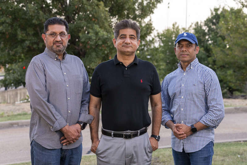 Rais Bhuiyan et al. posing for the camera: Plano resident Khalid Ishaq, Irving resident Nadeem Ahktar and Rais Bhuiyan on Tuesday, August 31, 2021, in Irving, Texas. Ahktar is the brother-in-law of Waqar Hasan, who was killed on September 15, 2001 by Mark Stroman, a white supremacist who went on an Islamophobic shooting spree following the September 11 terrorist attacks. Bhuiyan was targeted by Stroman...