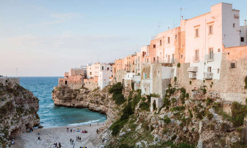 a castle surrounded by a body of water: Photograph: Matteo Colombo/Getty Images
