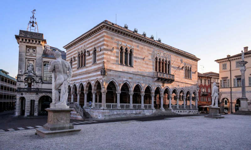 a large stone building: Piazza Libertà in Udine. Photograph: MassanPH/Getty Images
