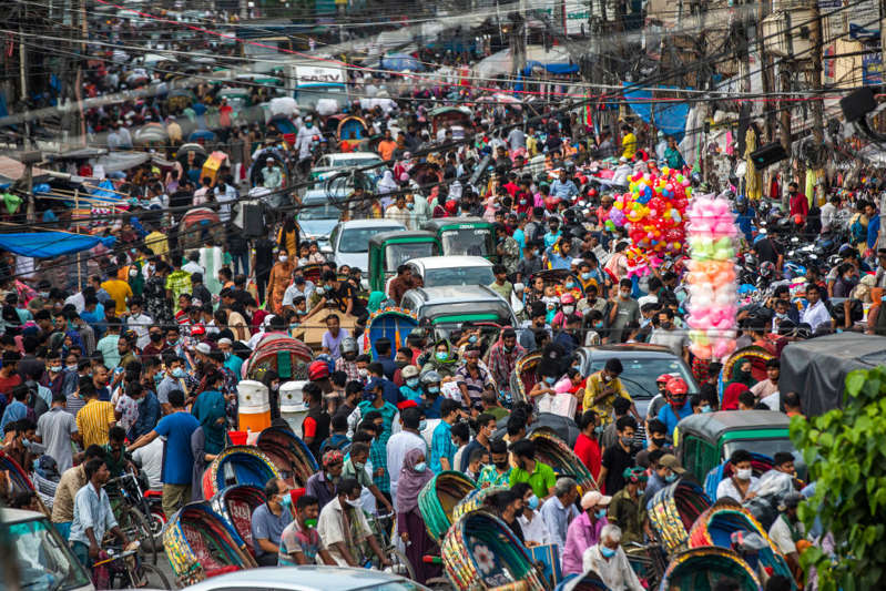 Shoppers look for clothes ahead of Eid-ul-Azha at the New Market in Dhaka on July 16, 2021. On the second day of the relaxation of the strict nationwide lockdown (Photo by Ahmed Salahuddin/NurPhoto via Getty Images)
