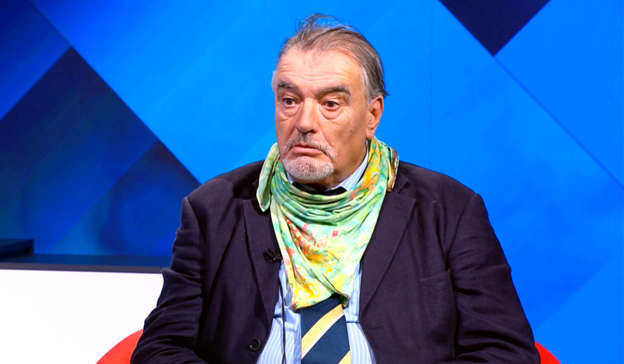 Ian Bailey wearing a blue shirt: A French court found Ian Bailey, 64, who has been the chief suspect in the gruesome murder, guilty in absentia of Sophie Toscan du Plantier's killing but the Irish justice system has never convicted him and refused to extradite him to France. Pic: Virgin Media Television