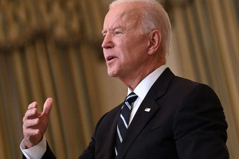 a man wearing a suit and tie: The Memo: Biden comes out punching on COVID-19