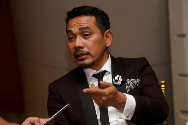 Rosyam Nor wearing a suit and tie: Datuk Rosyam Nor advised celebrities to withdraw from shooting if they are not willing to get vaccinated. — Picture by Choo Choy May