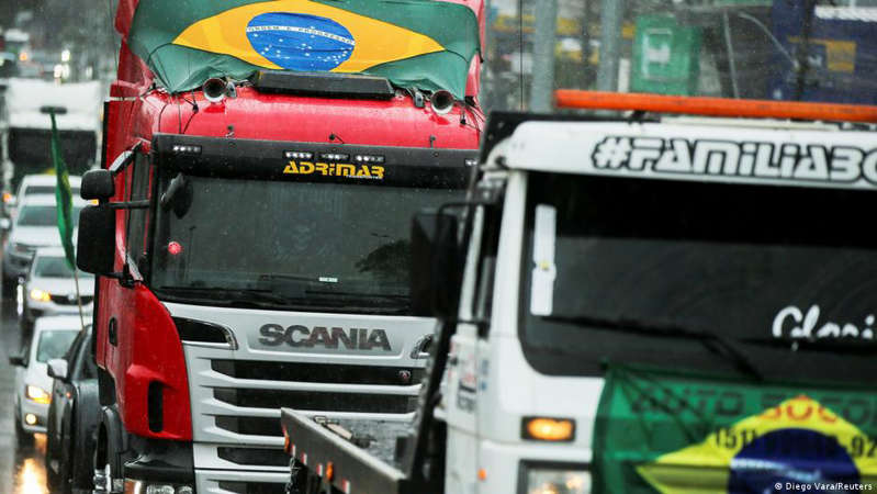 a bus driving down a street: The truck drivers' protests had blocked access to the Brazil's Supreme Court headquarters