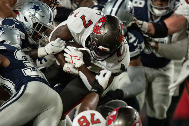 Slide 3 of 11: Tampa Bay Buccaneers running back Leonard Fournette (7) carries the ball against the Dallas Cowboys.