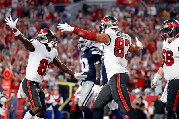 Slide 1 of 11: Tampa Bay Buccaneers tight end Rob Gronkowski celebrates with wide receiver Antonio Brown (81) after scoring a touchdown against the Dallas Cowboys.
