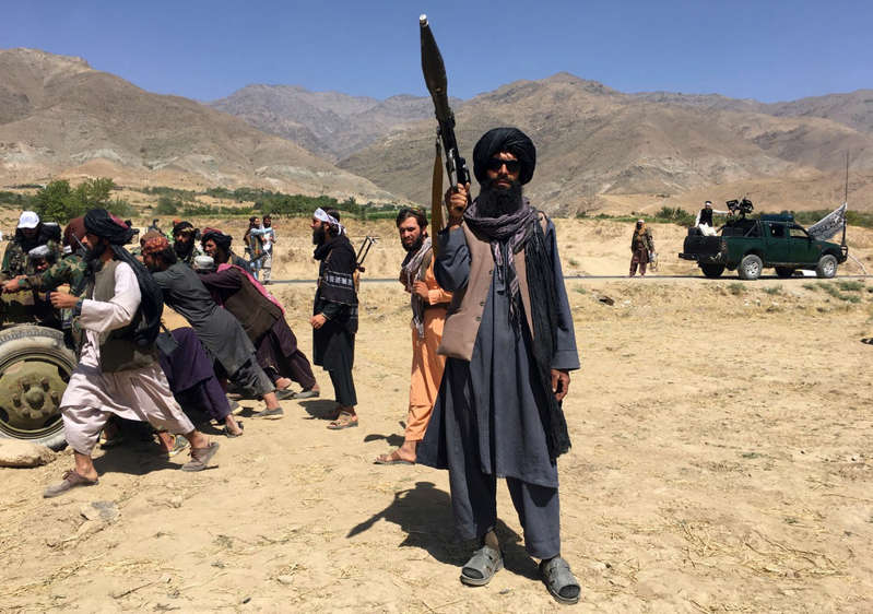 a group of people standing in a desert: Taliban soldiers in Panjshir province in northeast of Afghanistan on 8 September - Copyright 2021 The Associated Press. All rights reserved.