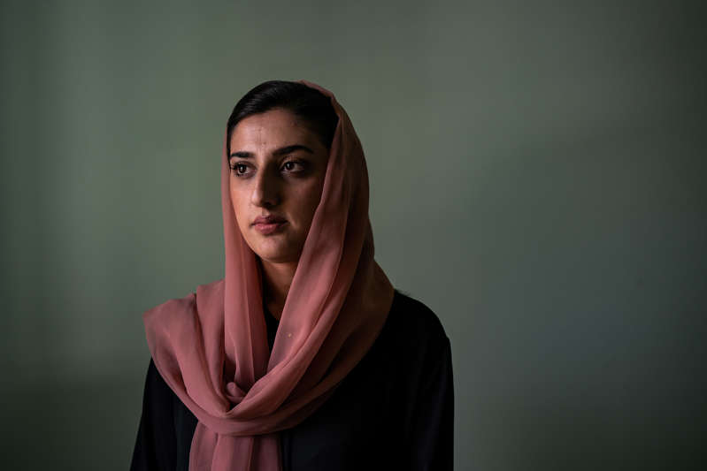 a person looking at the camera: A month before the Afghan capital fell to to the Taliban, Sara Qaderi received a letter stating the militants knew she worked for a U.S.-funded research program.