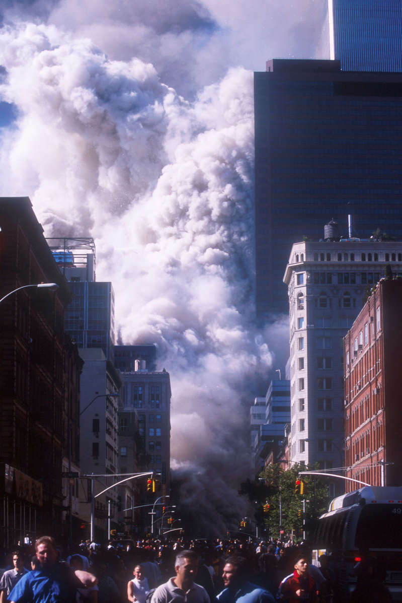 394273 04: People run away from the World Trade Center's twin towers after they collapsed following being struck by a commerical airliner in a suspected terrorist attack September 11, 2001 in New York City. (Photo by Ezra Shaw/Getty Images)