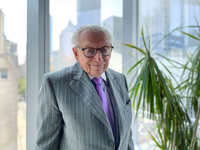 Real estate developer Larry Silverstein poses in front of 7 World Trade Center, August 2021.
