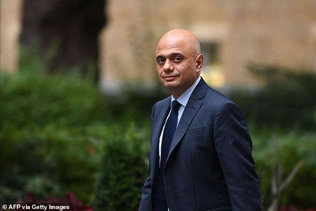 Sajid Javid wearing a suit and tie: (