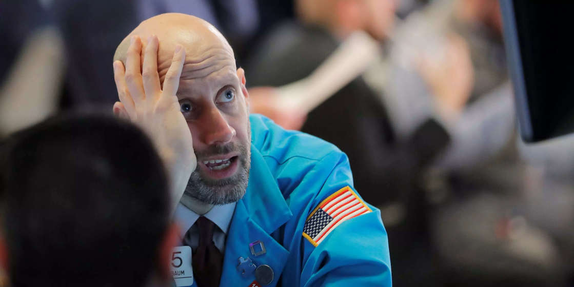 a close up of a man in a blue shirt: US stocks end week lower amid 5-day losing streak as growth concerns persist