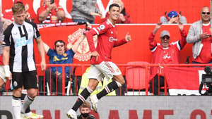 a group of football players posing for a picture: Cristiano Ronaldo celebrates after scoring the opening goal of the match between Manchester United and Newcastle.
