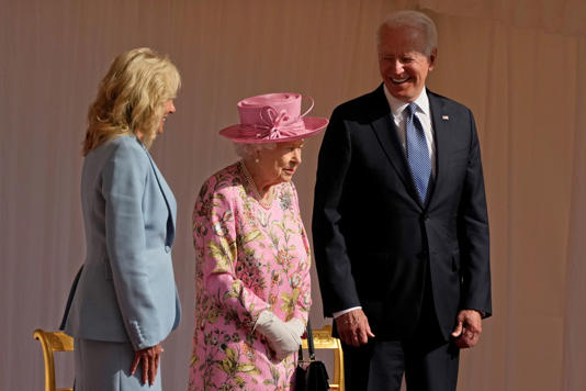 File: In this June 13, 2021, file photo US President Joe Biden and First Lady Jill Biden smile while standing with Britain's Queen Elizabeth II watching a Guard of Honour march past before their meeting at Windsor Castle near London. (AP Photo/Matt Dunham, Pool, File)