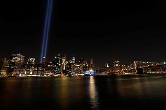 A general view of the Tribute in Light installation and the World Trade Center on the 20th anniversary of the September 11 attacks, from Brooklyn, New York City, U.S., September 11, 2021.  REUTERS/Mario Anzuoni