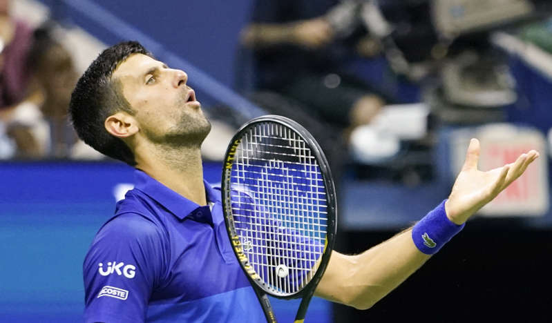 a close up of a person holding a racket on a court: Novak Djokovic frustrations