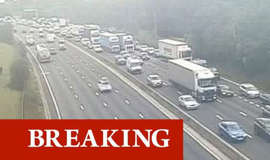 a car driving on a highway: m25 traffic update