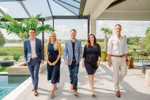 """a group of people posing for the camera: """"Realtors to Watch Under 40"""": Derek Patti, left, Madison Wells, David Crawford, Victoria Dominguez and Stephen Smith."""