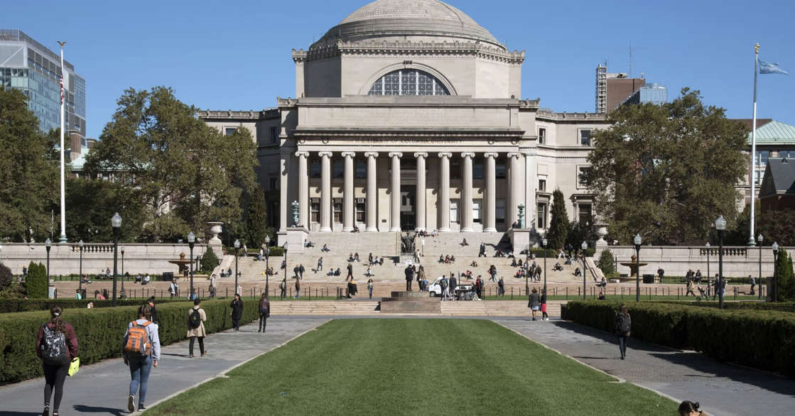 a group of people walking in front of a building: Columbia University