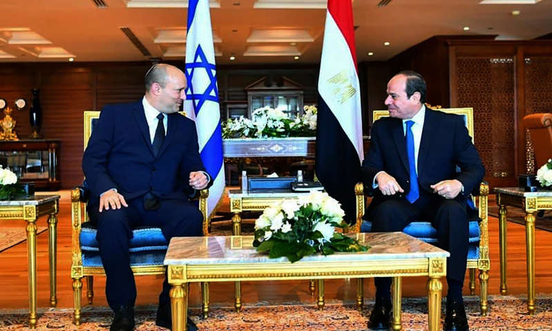 a group of people sitting at a table: Abdel-Fattah el-Sissi, right, meets Naftali Bennett in the Red Sea resort of Sharm el-Sheikh, Egypt.