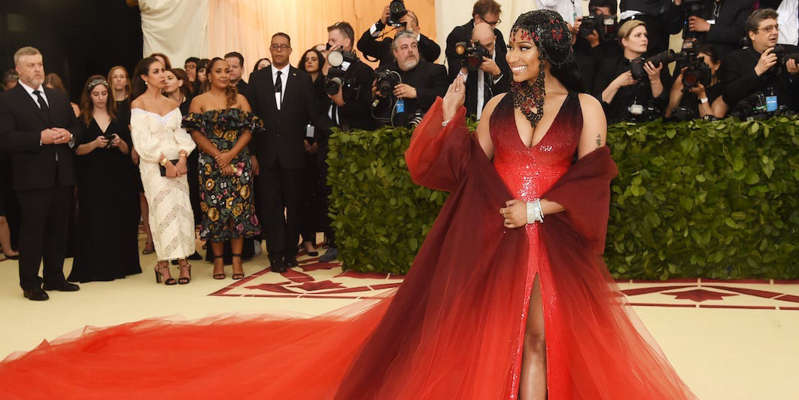 a group of people standing in front of a crowd posing for the camera: Nicki Minaj attends the Met Gala 2018. Jamie McCarthy/Getty Images