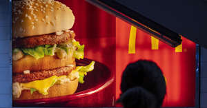 a sandwich sitting on top of a table: McDonald's is among the companies announcing that it will require its U.S.-based office workers to be vaccinated against the coronavirus.