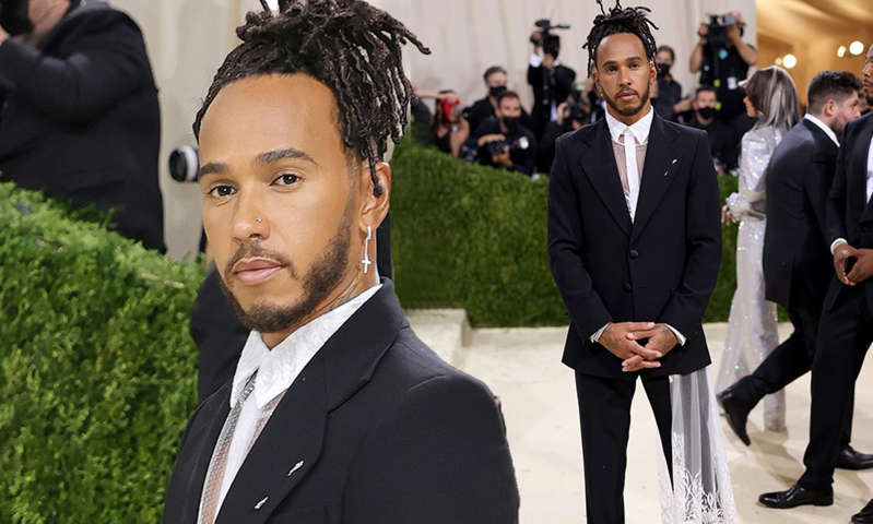 Lewis Hamilton, Lewis Hamilton standing next to a person in a suit and tie: MailOnline logo