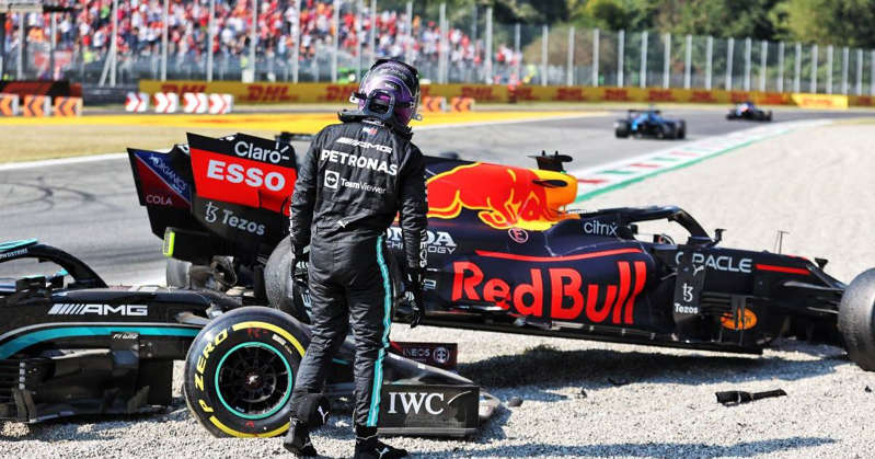 a man riding a motorcycle on a track: Lewis Hamilton at Monza crash scene planetF1