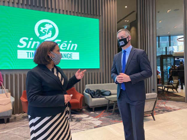 a man standing in front of a sign: Sinn Fein leader Mary Lou McDonald and TD Pearse Doherty at the party's think-in event in Dublin City centre (Dominic McGrath/PA)