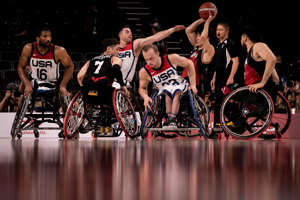 Trevon Jenifer et al. posing for the camera: USA and Japan competing in men's wheelchair basketball during the 2020 Tokyo Paralympics. Yasuyoshi Chiba/AFP via Getty Images