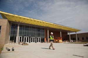 a man standing in front of a building: Alan Baird of Commercial Installation begins a day of work at the Battle Creek Middle School in Spring Hill on Wednesday, May 29, 2019. The school, along with the nearby Battle Creek Elementary School was completed that summer.